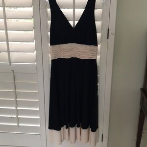 Black knee length dress with cream color accents